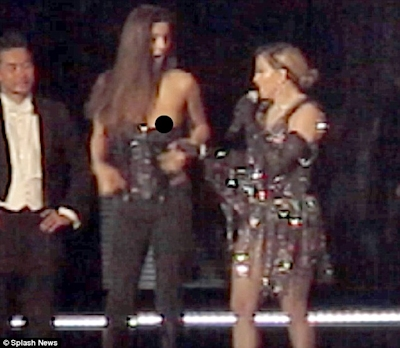 Outrageous: Madonna pulled down Josephine Georgiou's top after inviting her on stage during her concert in Brisbane, Australia on Thursday night
